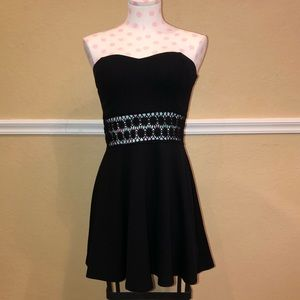 Coveted Clothing Black Dress with Cutouts